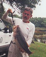Fishing Biologist Roy Greer with a Lake Fork trophy bass.